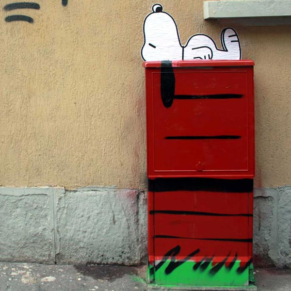 Snoopy, painted on a electric cabinet in Milan. Street art by Pao