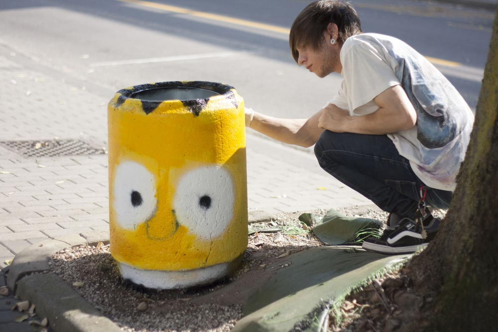 Bart Simpson painted on a street trash bin, street art by Pao