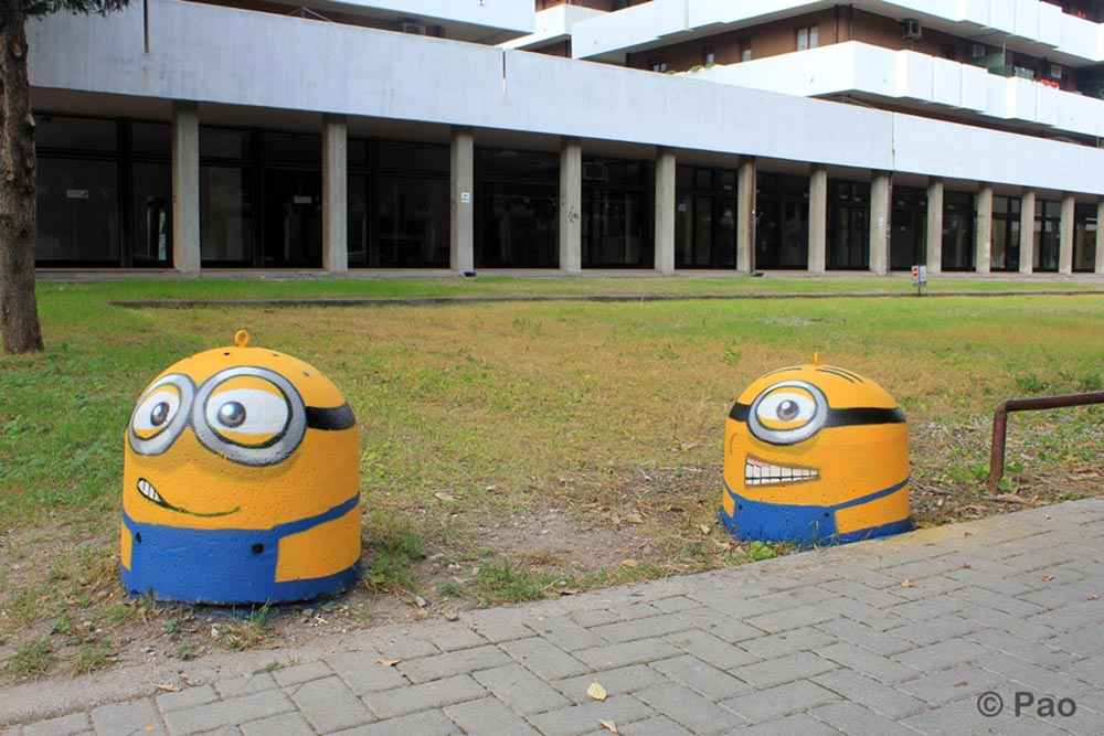 The minions painted on street furniture. Street art by Pao