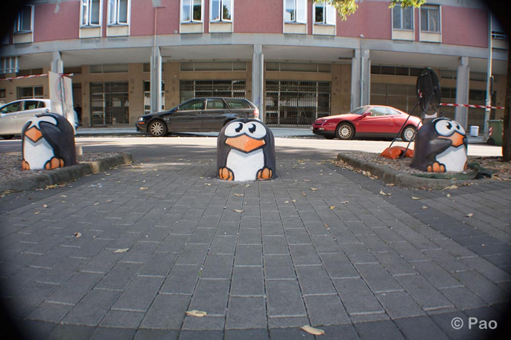 Penguins painted on street bollards in Mantova
